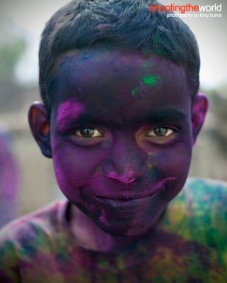 Portrait of a boy celebrating Holi