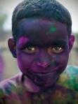 Portrait of a boy at Holi festival